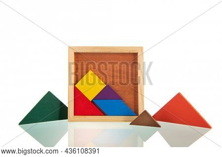 Colorful wooden puzzle isolated over white background