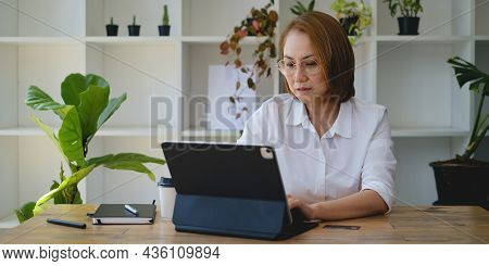 Adult Woman Focusing And Try To Using Stock Trading On Digital Tablet Application. Trade, Stock, Inv