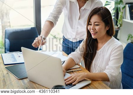 Adult Woman Teaching Her Friend To Stock Trading On Laptop Application. Trade, Stock, Invest Concept