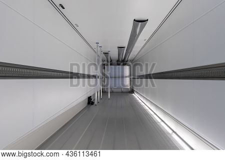 Empty Refrigerated Semi-trailer Inside, With Cargo Area Lighting. The Interior Of The New Trailer Fo