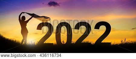 Silhouette Enjoying Women Flapping A Thin Fabric On The Hill While Celebrating 2022 Years In The Twi