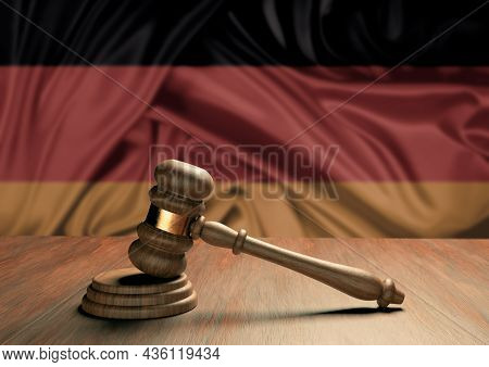 Wooden Judge's Gavel Symbol Of Law And Justice With The Flag Of Germany. German Judicial System. 3d