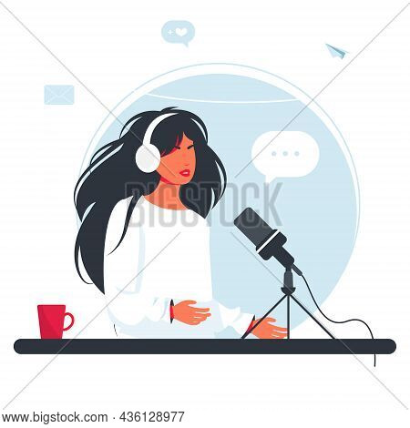 The Woman Is Recording A Podcast. Girl In Headphones Talking Into A Microphone. The Radio Dj Is Broa