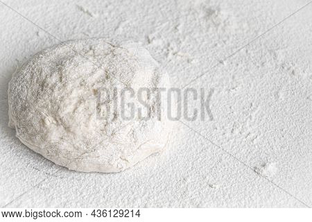 Lump Of Yeast Dough Sprinkled With Flour. Culinary Baking Background With Copyspace. Yeast Dough For