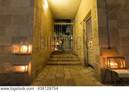 Jerusalem-israel. 12-12-2020. Hanukkah Candles Are Lit At The Entrance To Old Houses In The Jewish Q