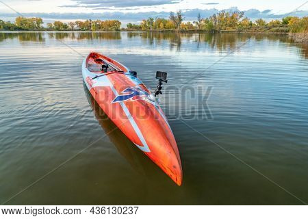 Fort Collins, CO, USA - October 7, 2021: GoPro Hero 10 action camera mounted with RAM mount and Seasucker suction cup on a deck of racing stand up paddleboard (17.6' Mistral Stealth).