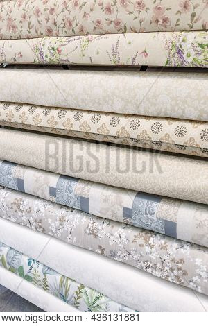 Sale Of Various Oilcloth Kitchen Tablecloths In Rolls On A Showcase In A Warehouse. Industrial Backg