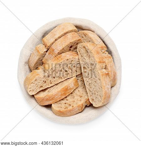 Cut Delicious Ciabatta In Wicker Basket Isolated On White, Top View