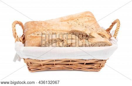 Delicious Ciabattas In Wicker Basket Isolated On White
