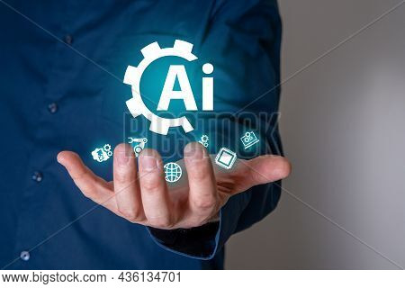 A Businessman On A Blurry Background Using A Digital Artificial Intelligence Icon. The Concept Of Ar
