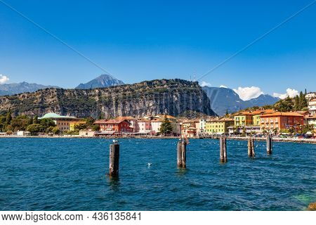 Colourful houses of Torbole resort town on the north shore of Lake Garda in Northern Italy