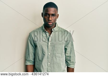 Young african american man wearing casual clothes depressed and worry for distress, crying angry and afraid. sad expression.