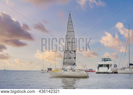 Yacht Sailing Against Sunset. Holiday Lifestyle Landscape With Skyline Sailboat And Sunset Silhouett