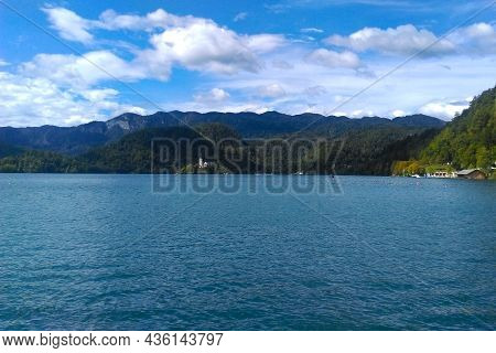Picturesque Mountain Lake Against The Blue Sky