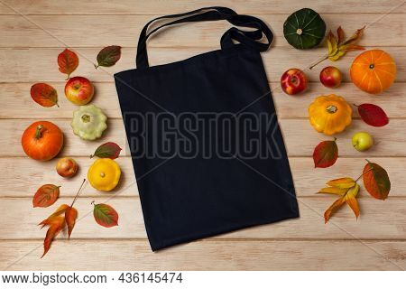Black Canvas Tote Bag Mockup With Fall Leaves, Small Pumpkins And Apples. Rustic Linen Shopper Bag M