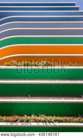 Underside View Of Balconies Of Multi-storey Multicolored Building. Public Or Office Building Exterio