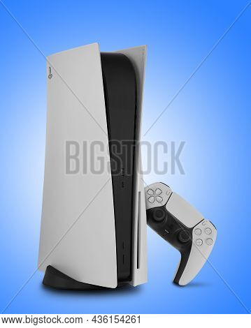 Hamburg, Germany - September 22. 2021.sony Playstation 5 Console And Controller On Blue Background.