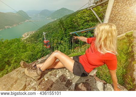 Woman Relaxing On Top Of San Giorgio Mount In Brusino Alps Of Switzerland. Swiss Cable Car Brusino-s