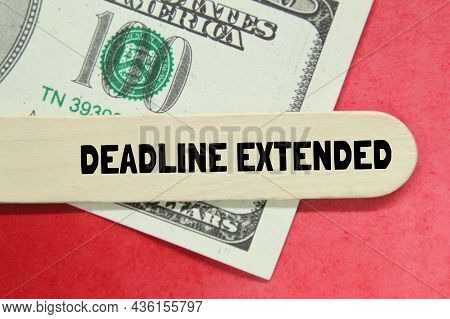 Banknotes, A Piece Of Board With The Word Deadline Extended