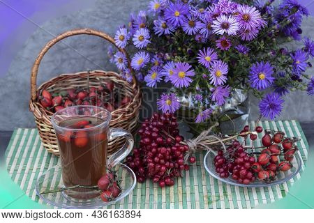 On The Napkin Is A Bouquet Of Autumn Flowers, A Basket Of Rose Hips, A Saucer With Viburnum And Rose
