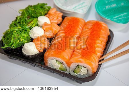 Salmon Sushi Set. Sushi Roll Philadelphia With Red Fish, Salmon, Red Caviar. Roll With Soft Avocado