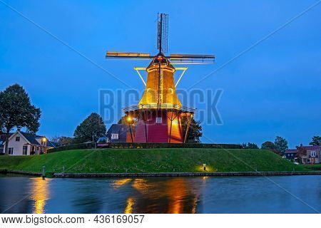 Windmill De Hoop in the historical city Dokkum in the Netherlands at sunset