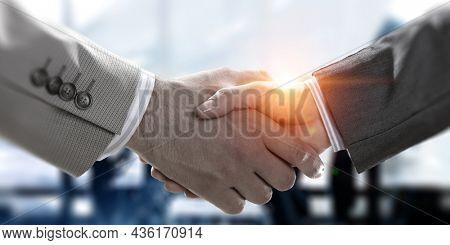 Partnership concept. Image of handshake. Mixed media