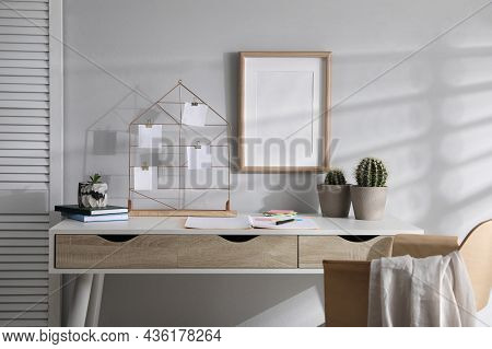 Memo Board With Notes On Table In Home Office