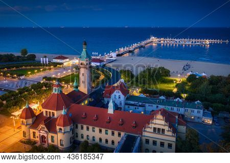 Beautiful architecture of Sopot city at the pier (Molo) by the Baltic Sea at dusk, Poland.