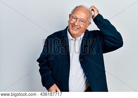 Senior man with grey hair wearing casual style and glasses confuse and wonder about question. uncertain with doubt, thinking with hand on head. pensive concept.