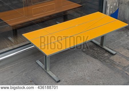 Yellow Coffee Table Furniture At Street Pavement