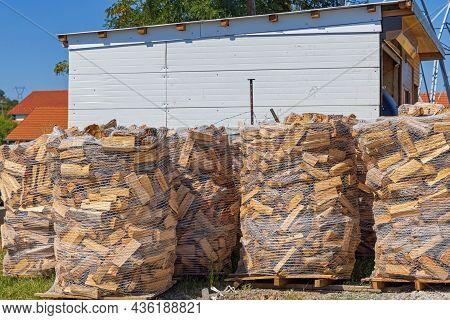 Pallets Of Firewood In Net Ready For Winter Season