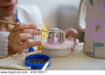Cropped Image Of Self Employed Ceramist Craftswoman Drawing Decoration On Ceramic Cup For Clay Jug D