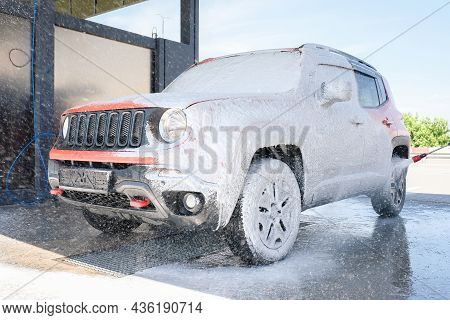 Car Wash With Soap. Car Cleaning With High Pressure Water And Foam
