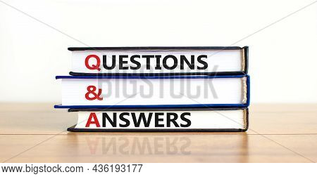 Q And A, Questions And Answers Symbol. Concept Words 'q And A Questions And Answers' On Books On A B