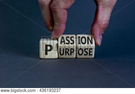 Passion Or Purpose Symbol. Businessman Turns Wooden Cubes And Changes The Concept Word 'purpose' To