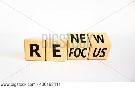 Refocus And Renew Symbol. Businessman Turned Cubes And Changed The Word 'refocus' To 'renew'. Beauti