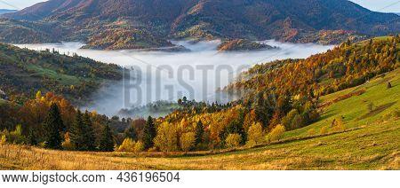 Morning Foggy Clouds In Autumn Mountain Countryside.  Ukraine, Carpathian Mountains, Transcarpathia.