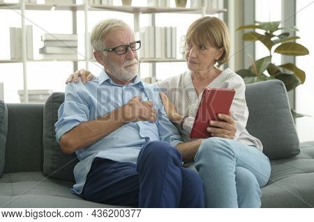 Caucasian Senior Elderly People  Are Video Call With Doctor , Telehealth , Health Care Technology Co