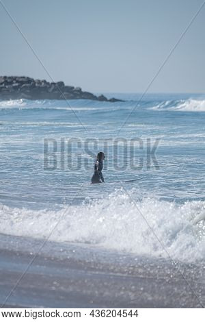 Soul Surfer Girl Entering The Ocean In Furadouro Beach, Ovar - Portugal.