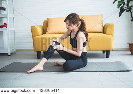 Asian Attractive Young Woman, Is Currently Having A Knee Injury During His Exercise In Home, Due To