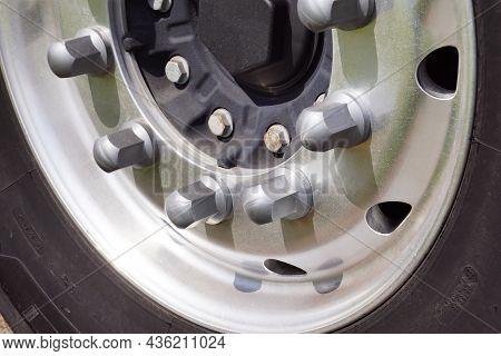 Tire, Rim, Bolts. Closeup Of A Truck Wheel.