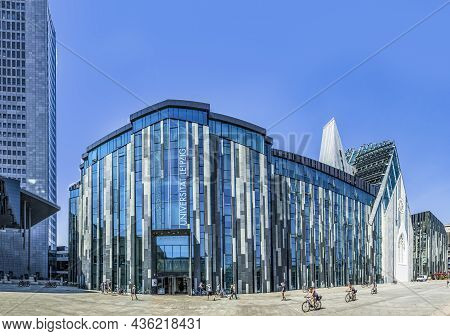 Leipzig, Germany - August 4, 2015: Students In Front Of The Modern University Of Leipzig On A Hot Su