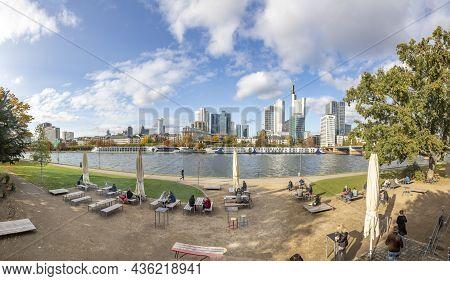 Frankfurt, Germany - October 24, 2020: People Enjoy The Sun And The Panoramic Skyline Of Frankfurt W