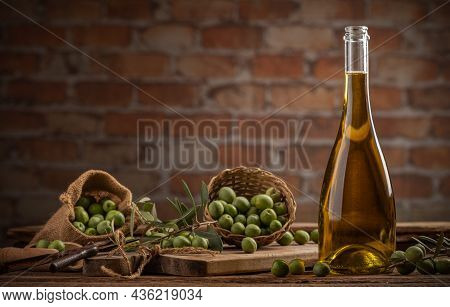 Bottle Of Extra Virgin Olive Oil On A Table With Concrete Wall Backgound