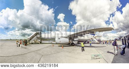 Frankfurt, Germany -  July 11, 2020: People Are Boarding The Aircraft With Distance And Face Masks A