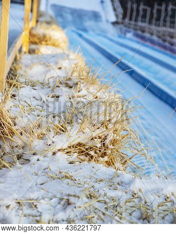 Blocks Of Straw Covered With Snow That Line The Toboggan Run In Winter. Arrangement Of Protective Fe