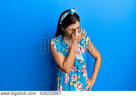 Young latin woman wearing casual clothes tired rubbing nose and eyes feeling fatigue and headache. stress and frustration concept.