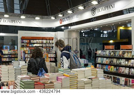 International Book Fair, Turin, Italy - 14 October 2021: Visitors Stroll Through The Stands Of Publi
