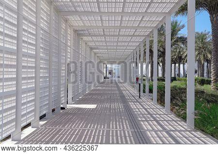 Diminishing Futuristic Perspective View Of Entering White Trellis Passageway To Famous Louvre Art Mu